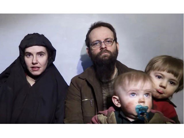 A still image from a video posted by the Taliban on social media on 19 December 2016 shows American Caitlan Coleman, left, speaking next to her Canadian husband Joshua Boyle and their two sons. PHOTO: REUTERS