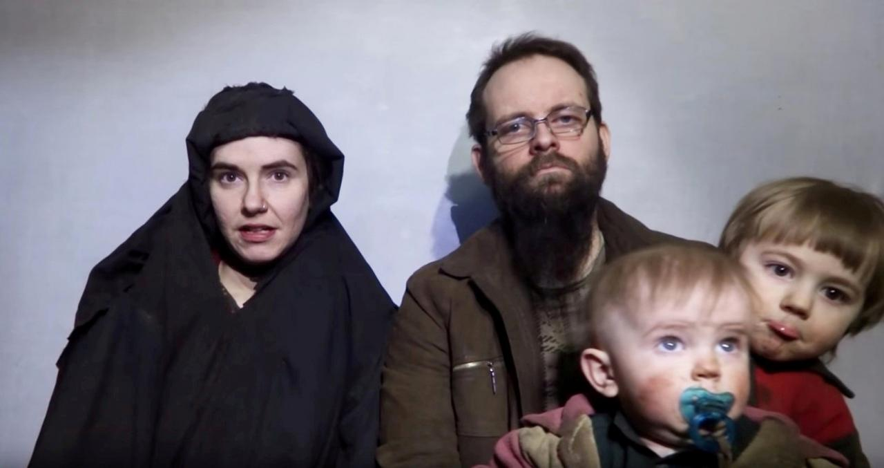 A still image from a video posted by the Taliban on social media on December 19, 2016 shows American Caitlan Coleman (L) speaking next to her Canadian husband Joshua Boyle and their two sons.  PHOTO: REUTERS