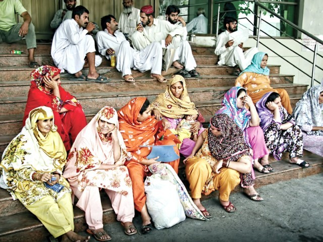 Patients waiting outside Services Hospital (Top); no doctors inside the OPD at Sir Ganga Ram Hospital  PHOTO: ABID NAWAZ AND RIAZ AHMED/EXPRESS