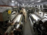 an-employee-works-at-the-production-line-of-a-textile-mill-on-the-outskirts-of-ahmedabad-2-2-2-2-2-2-2-2-2-3-2-2-2-2-2-2-2-2-2-2