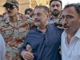 Law enforcers arrest Sharjeel Memon from outside Sindh High Court in Karachi on Monday. PHOTO: INP