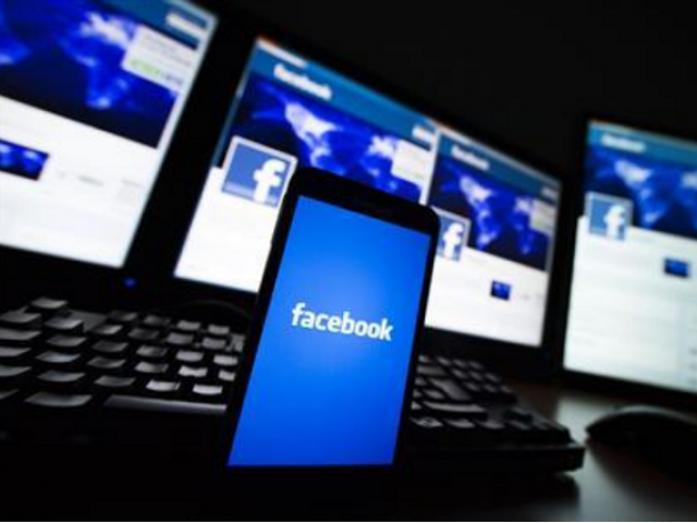 The loading screen of the Facebook application on a mobile phone is seen in this photo illustration taken in Lavigny May 16, 2012.  PHOTO: REUTERS
