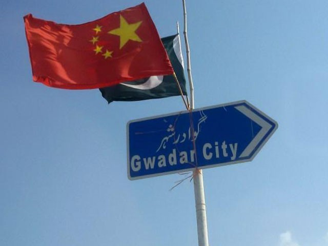 The Chinese and Pakistani flags fly on a sign along a road towards Gwadar, Pakistan January 26, 2016. PHOTO: REUTERS