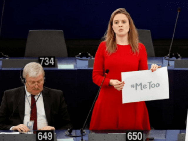 "European Parliament member Terry Reintke (C) holds a placard with the hashtag ""MeToo"" during a debate on sexual harassment at the European Parliament on Oct. 25, 2017.PHOTO:REUTERS"