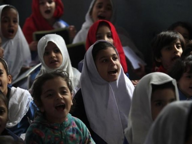 Girls recite their doctrine while attending their daily category during a supervision propagandize in Peshawar on Oct 29, 2014. PHOTO: REUTERS