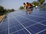 solar-technicians-install-solar-panels-on-the-roof-of-a-house-october-25-2013