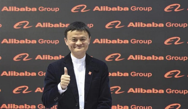 Alibaba founder and chairman Jack Ma poses for the media while touring the CeBIT trade fair in Hanover March 16, 2015.  PHOTO: REUTERS