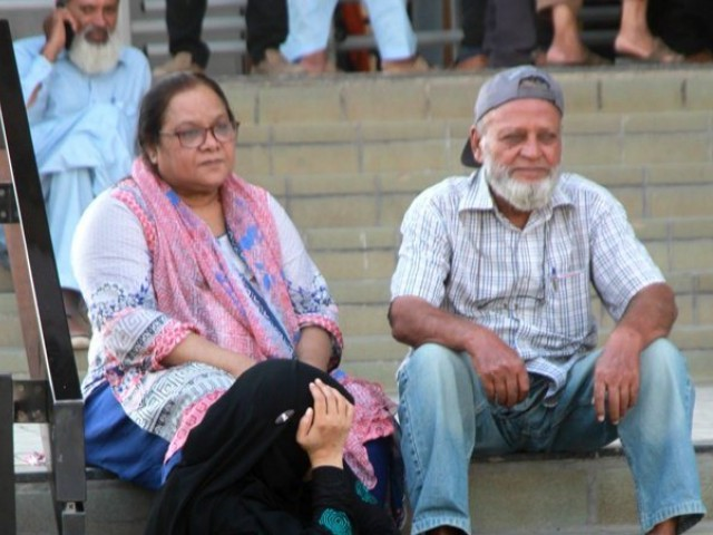 Aged people sitting on the stairs waiting for their turn at a biometric verification centre. PHOTO: ATHAR KHAN