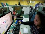 file-photo-a-call-center-agent-talks-to-a-client-in-the-u-s-as-she-works-the-overnight-shift-in-manila