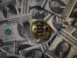 a-bitcoin-virtual-currency-coin-placed-on-dollar-banknotes-is-seen-in-this-illustration-picture