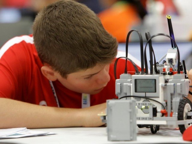 A participant from Canada prepares his miniature robot during the World Robot Olympiad  PHOTO: REUTERS