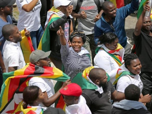 Protesters march calling for Zimbabwean President Robert Mugabe to step down in Cape Town South Africa