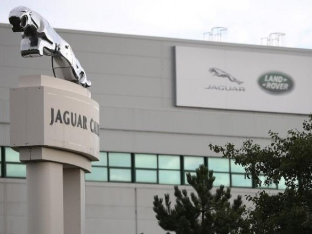 Signs are seen outside the Jaguar Land Rover plant at Halewood in Liverpool northern England September 12, 2016