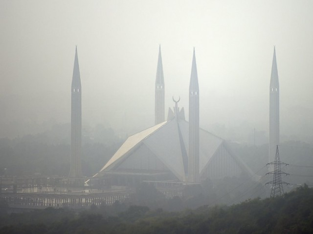 The grand Faisal Mosque is seen covered in heavy smog in Islamabad. PHOTO: AFP