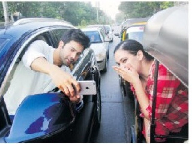 Varun Dhawan's selfie stunt on road leads to challan