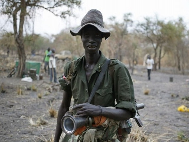File Photo: A rebel fighter carries a rocket-propelled grenade (RPG) in a rebel camp in Jonglei State, Feb. 1, 2014. PHOTO: REUTERS
