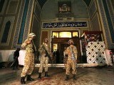 Soldiers stand guard outside Lal Shahbaz Qalandar's shrine. PHOTO: APP