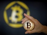 a-bitcoin-virtual-currency-coin-is-seen-in-an-illustration-picture-taken-at-la-maison-du-bitcoin-in-paris-10