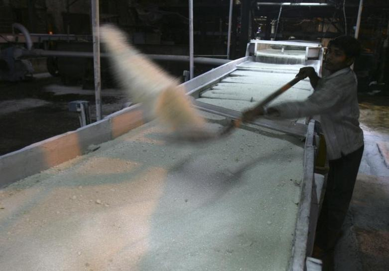 An employee works inside a sugar mill. PHOTO: REUTERS