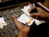 an-employee-counts-cigarettes-before-packing-them-in-sidoarjo-indonesias-east-java-province-2-2-2-2-2-2-2-2-2