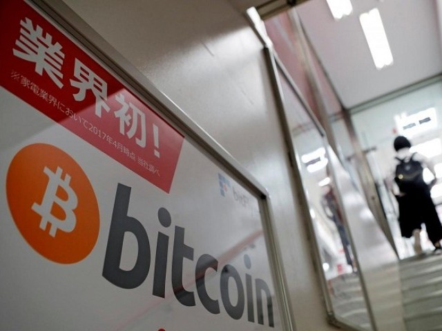 A logo of Bitcoin is seen on an advertisement of an electronic shop in Tokyo, Japan September 5, 2017. PHOTO: REUTERS