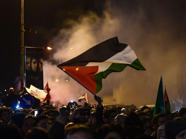 Protesters wave Palestinian flags during a demonstration against the US and Israel in front of the US consulate in Istanbul. PHOTO: AFP