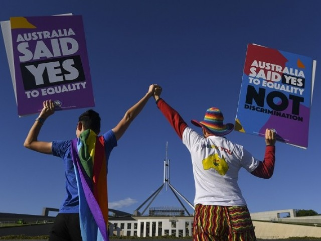 Same-sex marriage campaigners pose for pictures during an equality rally outside Parliament House in Canberra December 7, 2017.  Photo via REUTERS