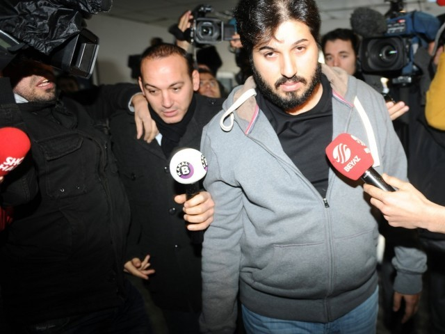 Detained Azerbaijani businessman Reza Zarrab is surrounded by journalists as he arrives at a police center in Istanbul