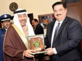 Defence Minister Khurram Dastgir presents a shield to Saudi Deputy Defence Minister Muhammad bin Abdullah. PHOTO: NNI