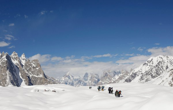 Trekkers and porters hike down the Baltoro glacier in the Karakoram mountain range in Pakistan. PHOTO: REUTERS
