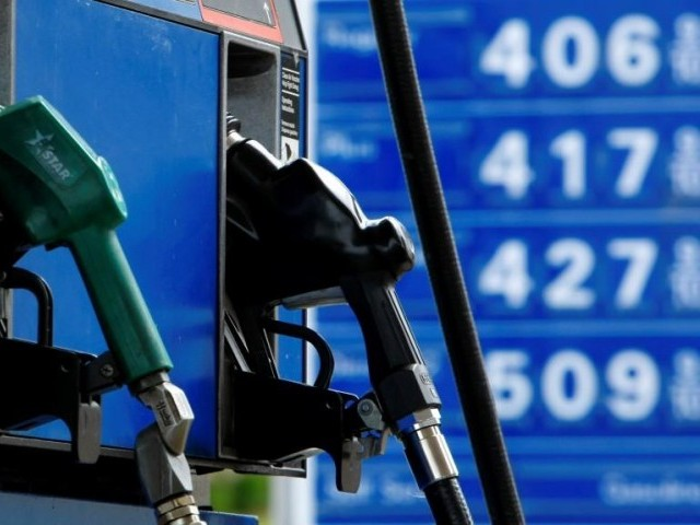 Gas and diesel pumps along with gas prices are shown at a gas station. PHOTO: REUTERS