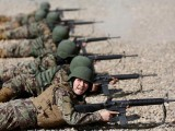 20 Afghan women officers are being put through their paces at a military training academy in India. PHOTO:REUTERS
