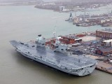 the-royal-navys-aircraft-carrier-hms-queen-elizabeth-is-docked-the-day-it-was-commissioned-by-britains-queen-elizabeth-in-portsmouth