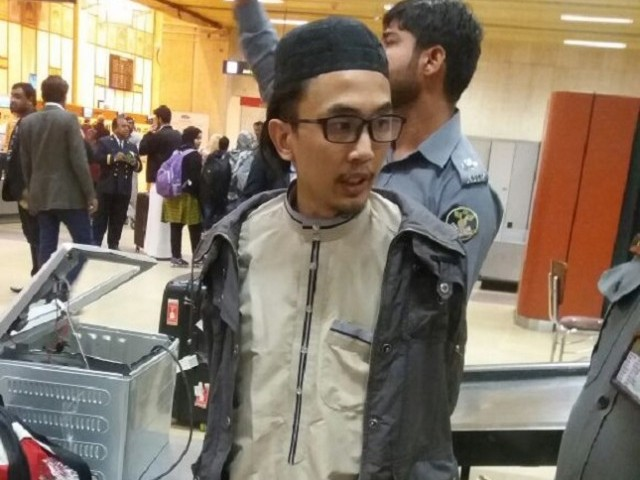 The security officials are trying to question him and ascertain as to why he would conceal pistols and ammunitions in his luggage. PHOTO: EXPRESS