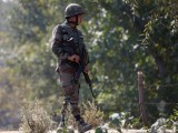an-indian-army-soldier-patrols-along-a-highway-on-the-outskirts-of-srinagar-3-2