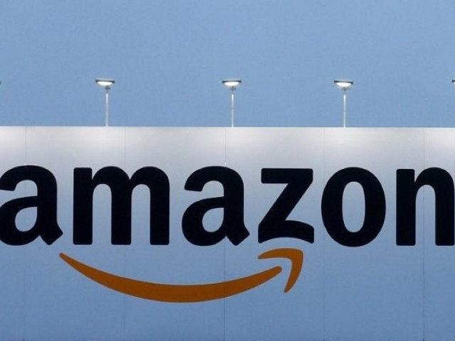 The Logo Of Amazon Is Seen At Company Logistics Center In Lauwin Planque