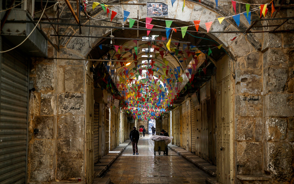 A view of closed shops in an alley in the city of Nablus in the occupied West Bank, as people go on strike protesting against the visit of US Vice President to Israel and Jerusalem. PHOTO: AFP