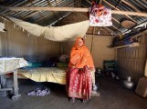 marzina-bibi-poses-inside-her-house-in-fofonga-village-in-goalpara-district-in-the-northeastern-state-of-assam