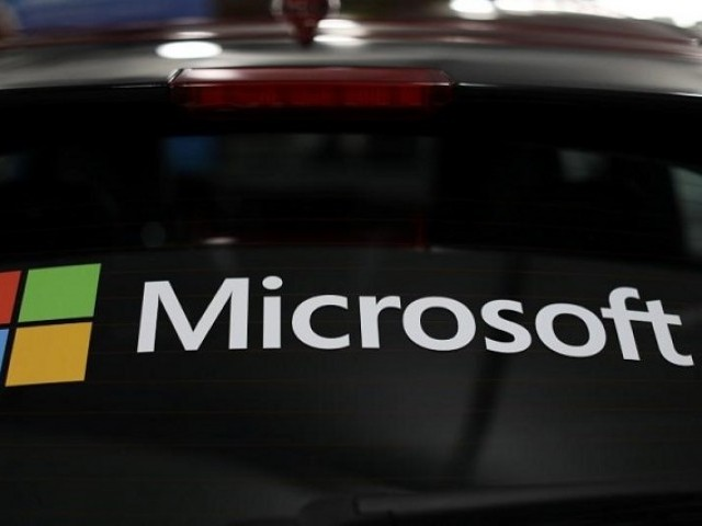 The Microsoft logo is shown on an electric car at the Auto Show in Los Angeles California US