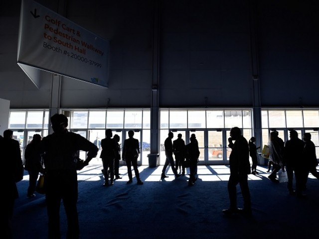 Attendees stand around after the power went out during CES 2018 inside the central hall at the Las Vegas Convention Center on January 10, 2018 in Las Vegas, Nevada. PHOTO: AFP