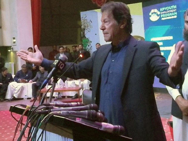 PTI chief Imran Khan addresses a ceremony in Peshawar on Friday. PHOTO: TWITTER/@BabaKiR46675241