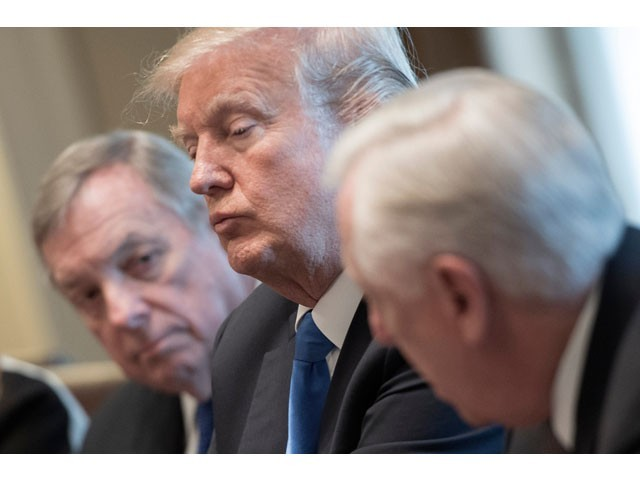 This file photo taken on January 9, 2018 shows US President Donald Trump (C) and US Senator Dick Durbin (L), D-Illinios, listen as US Congressman Steny Hoyer (R), D-Maryland speaks during a meeting with bipartisan members of the Senate on immigration at the White House in Washington, DC. PHOTO: AFP