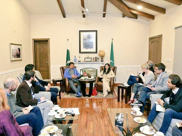 Imran Khan speaks to foreign media at Bani Gala. PHOTO: Twitter @anilakhawaja