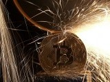 file-photo-sparks-glow-from-broken-bitcoin-virtual-currency-coins-in-this-illustration-picture