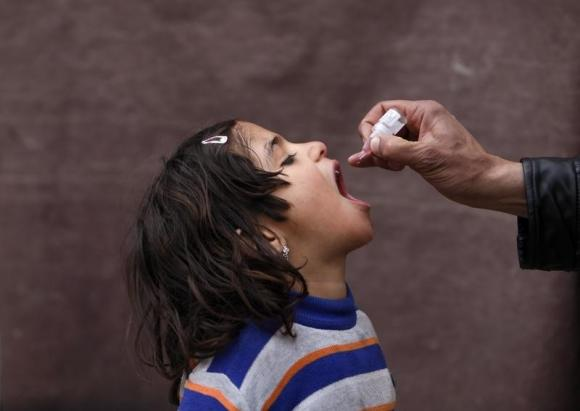 2 polio vaccinators shot dead in Pakistan