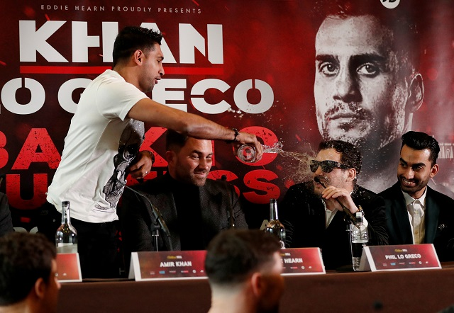 boxing   amir khan press conference   liverpool britain   january 30 2018 amir khan throws water into the face of phil lo greco during the press conference as promoter eddie hearn looks on photo reuters