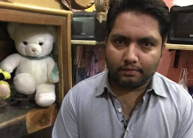 Ayesha's father has still kept the white teddy bear he received as a birthday present from her. PHOTO: BBC