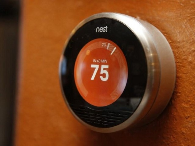 Alphabet shifts thermostat maker Nest into Google