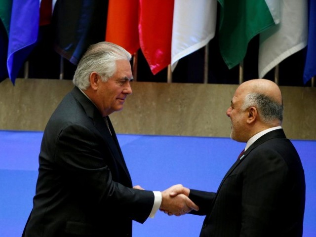 US Secretary of State Rex Tillerson greets Iraqi Prime Minister Haider al-Abadi at the State Department in Washington, DC. PHOTO: REUTERS