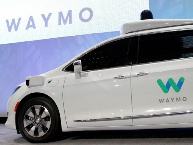 Waymo unveils a self-driving Chrysler Pacifica minivan during the North American International Auto Show in Detroit Michigan US